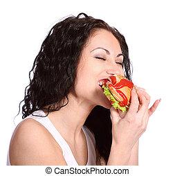 young woman with hamburger