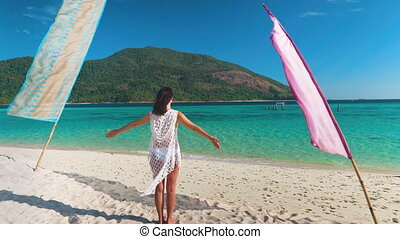 Young woman with hands up relax and enjoy turquoise sea on ...