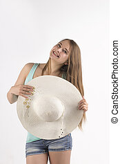 young woman with hat in studio