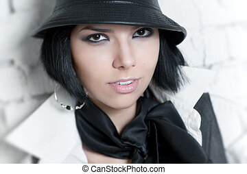 Young woman with hat portrait