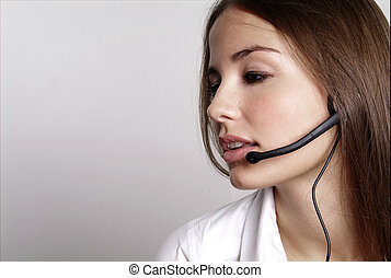 young woman with head set - young friendly woman with one ...