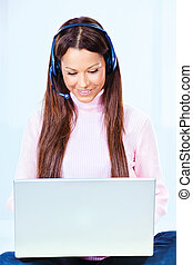 young woman with headphones and  laptop