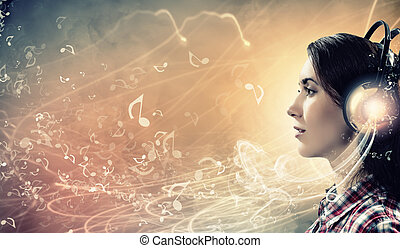 Young woman with headphones - Image of young pretty woman...