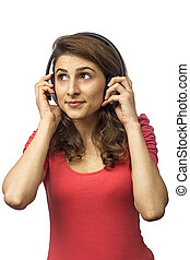 Young woman with headphones daydreaming