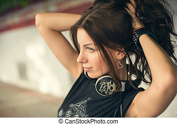 Young woman with headphones in the city