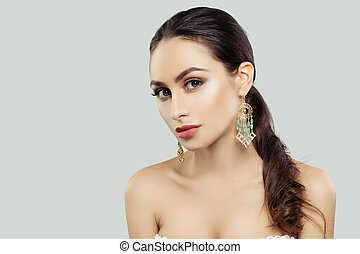 Young Woman with Healthy Skin, Makeup, Healthy Hairstyle and Jewelry