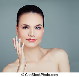 Young woman with healthy skin on blue background. Cosmetology, skincare, spa and wellness concept