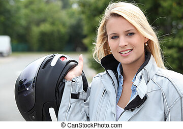 Young woman with helmet for motorcycle