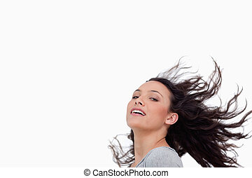Young woman with her hair in motion