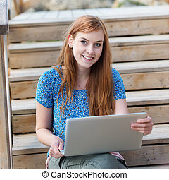 Young woman with her laptop