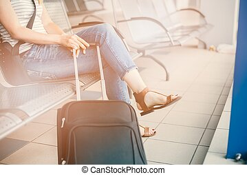 woman with her luggage at the airport