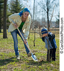 woman with her son resetting tree