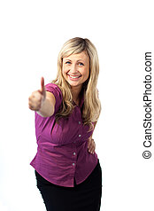 Young woman with her thumb up to camera