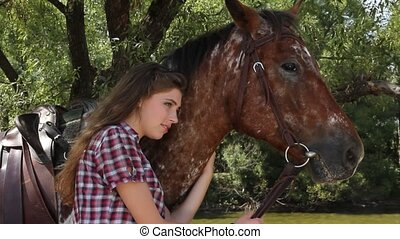 Young woman with horse