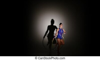 Young woman with jumping rope in her hand, slow motion