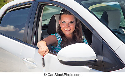 young woman with keys of car