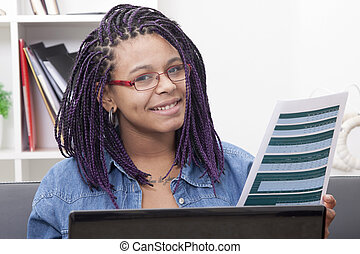 young woman with laptop computer and the document, paper or bill