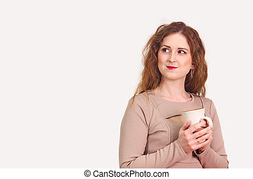 young woman with large mug of tea on white background