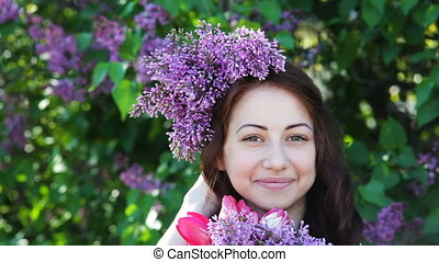 Young woman with lilac wreath