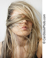 Young woman with long beautiful healthy blond hair
