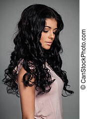 Young Woman with Long Curly Hair, Fashion Portrait