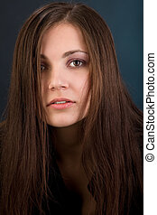 Young woman with long hair in sad