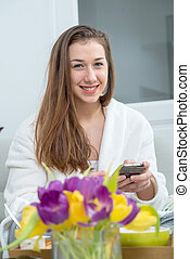 young woman with long hair using smartphone