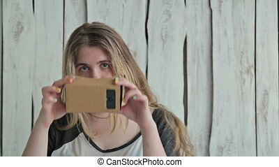 Young woman with long hair using Virtual Reality Glasses