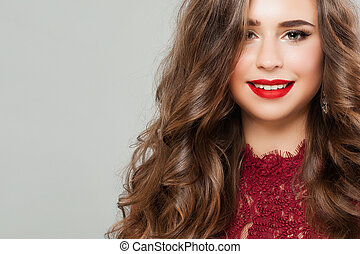 Young Woman with Long Healthy Permed Hair. Portrait of Cute Smiling Girl Fashion Model with Red Lips Makeup