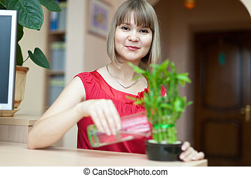 Young woman with lucky bamboo