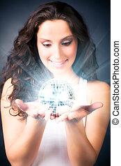 Young woman with magic shine ball