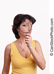 Young woman with magnifying glass a
