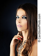 Young Woman with Makeup. Beauty Fashion Portrait