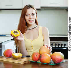 young woman with mango