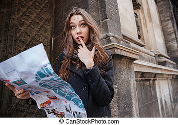 Young woman with map