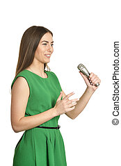Young woman with microphone on white background