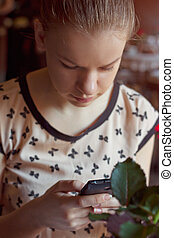 young woman with mobile phone in cafe