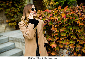 Young woman with mobile phone outdoor
