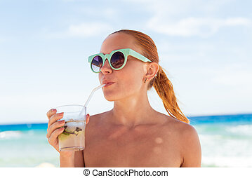 Young woman with mojito