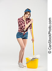 Young woman with mop - Beautiful young woman standing with...
