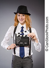 Young woman with movie board