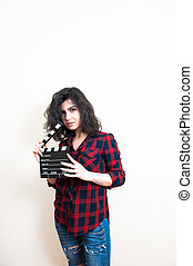 Young woman with movie clapper board on white background