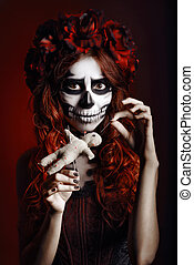 Young woman with muertos makeup (sugar skull) piercing ...