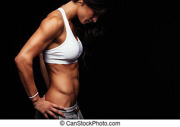 Young woman with muscular body