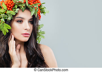 Young woman with natural makeup, perfect skin and healthy hair on background with copy space