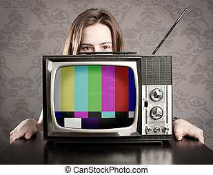 woman with old retro tv