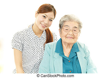 Young woman with old woman