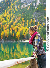 Young woman with on lake braies in south tyrol, italy ...
