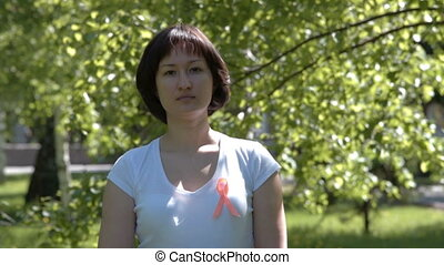 Young woman with orange awareness ribbon - Young brunnete...