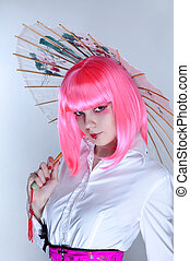 Young woman with oriental make-up holding Japanese umbrella...